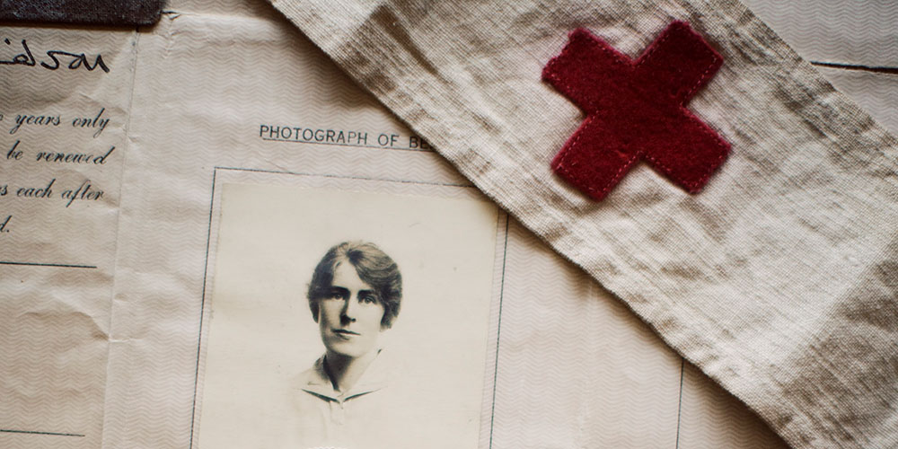 items from the Frances Cluett collection, including photos, personal sketches, passport, and VAD armband