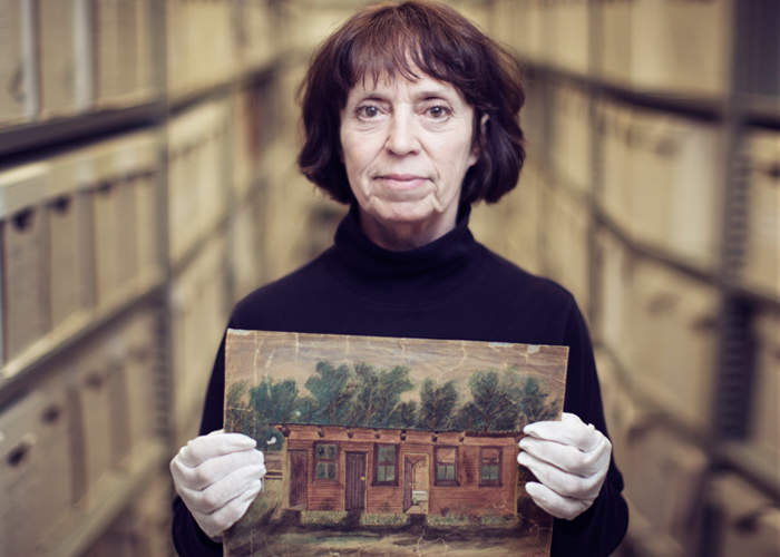 Linda White holds a sketch drawn by Frances Cluett that depicts the field hospital where she served as a VAD