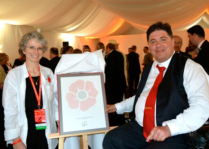 Dr. Karen Ewing presents a plaque to Kent Hehr, minister of Veterans Affairs, at a reception prior to the commemoration ceremonies on July 1, 2016 at the Beaumont-Hamel Newfoundland Memorial in France.  PHOTO: Submitted