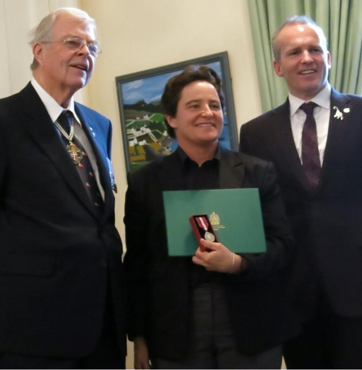 Dr. Loeffler accepts her Queen's Jubilee Medal from MP Ryan Cleary (right) and Lt.-Gov. John Crosbie